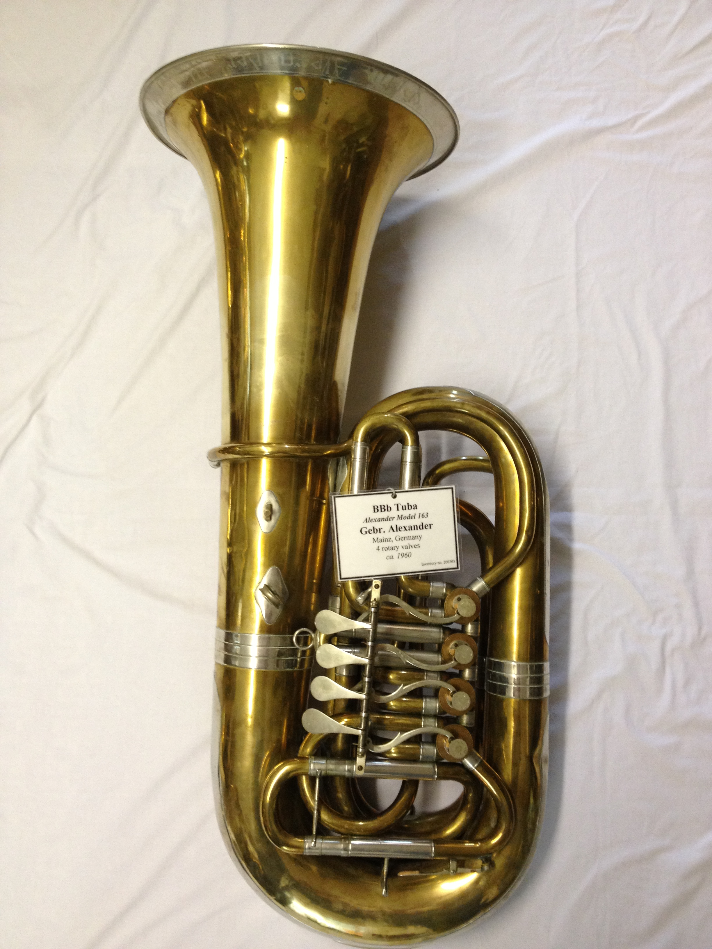 the tuba A tuba is a brass instrument characterized by its large size and deep sound it consists of vertically coiled tubing, three or four valves, a wide conical.